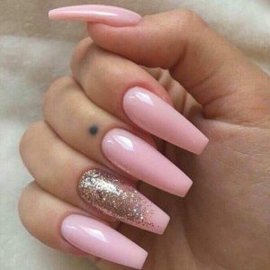 acrylic extensions with pink colour and glitters