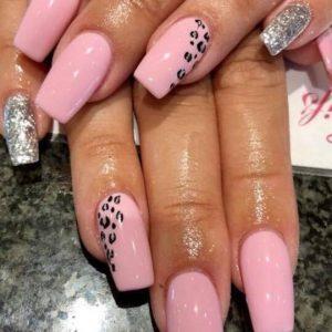 acrylic nail extensions with pink nail polish and animal print design