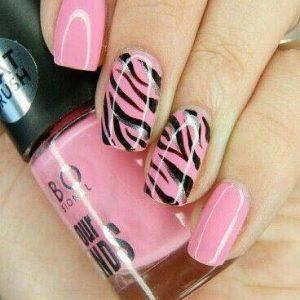 black zebra on pink nail design