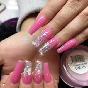 long pink nail extensions with sparkling glitter