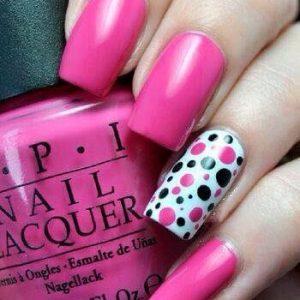 opi nail pink polish with polka dot design