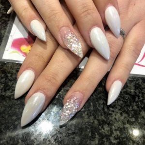 pointed nail extensions with glittering design