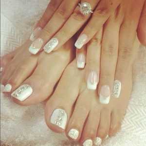 shellac gel nails and toes with white tips and glittering design