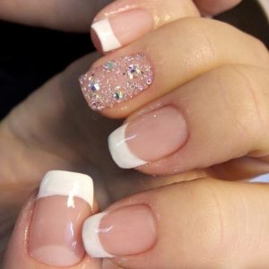 shellac nail with white tips and glittering design