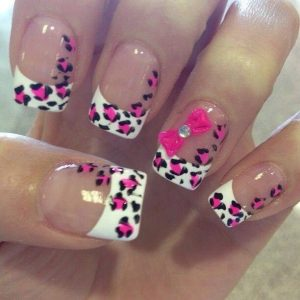 white tip with animal print hand design