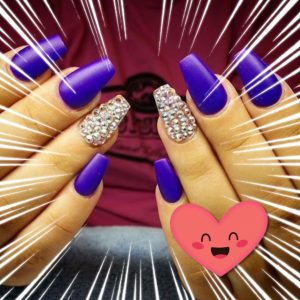 coffin shaped nails with sparkling stone design