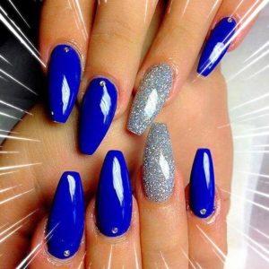 dark blue nails with diamond design