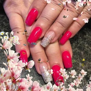red nail extensions with glitter tip design